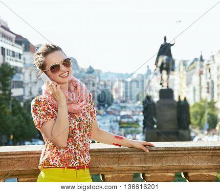 Happy Woman Talking Smartphone At Wenceslas Square In Prague
