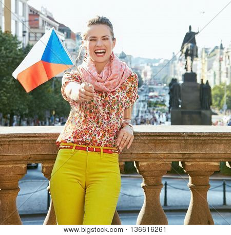 Smiling Woman Showing Czech Flag At Wenceslas Square In Prague