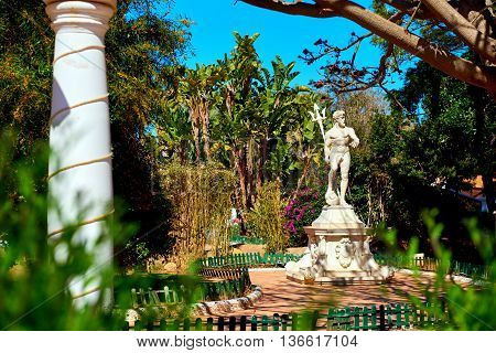 Neptune statue in the Marina d'Or garden. Oropesa del Mar resort town. Spain