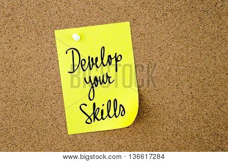 Develop Your Skills Written On Yellow Paper Note