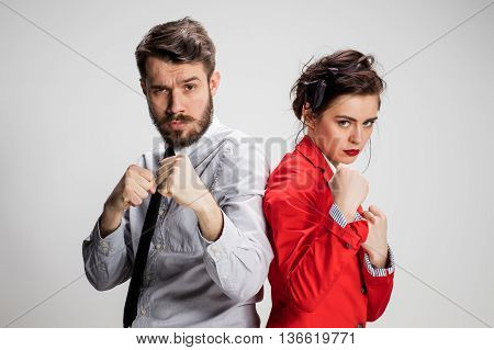 The militant business man and woman on a gray background