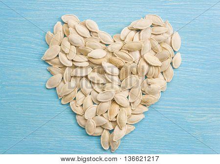 Pumpkin seeds forming a heart. Super food. Clean organic seeds. Fresh fall harvest. Organic seeds.