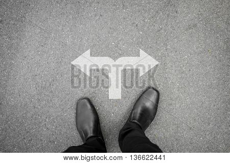 black shoes standing at the crossroad two ways to choose