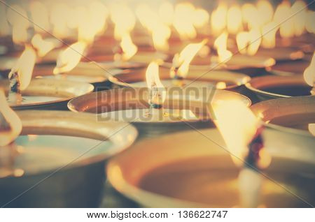 Spiritual oil lamps in temple. for meditation consciousness. - vintage effect