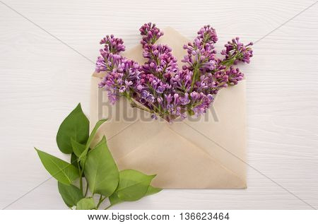 Colorful spring flowers in envelope flower delivery concept