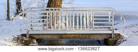 Small bridge over the creek, beautiful winter landscape