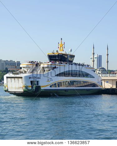 Istanbul, Turkey - May 29, 2016:  Strait of Istanbul, Kadikoy Pier. Ferries are the most popular form of public transport in Istanbul for one simple reason - if you're a local, you're always in a hurry except when you're on a ferry travelling from one sid