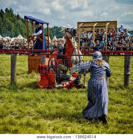 Russia Moscow region village Morozova - June 25 2016: Knight fallen from his horse after hitting a spear at the festival of the middle Ages. Historical club