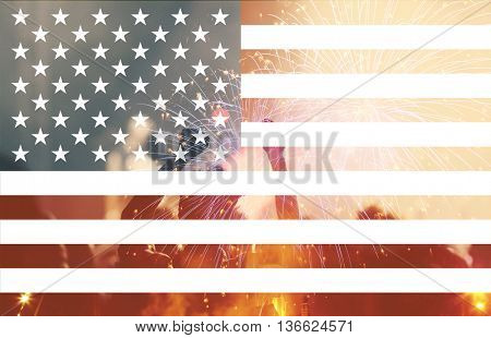 Celebratory fireworks and crowd of people on the background of the US flag. Independence day, 4th f July