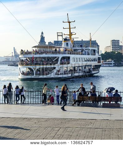 Istanbul, Turkey - May 29, 2016: Strait of Istanbul, Kadikoy Pier. Strait of Istanbul, Kadikoy Pier and Ferries. Ferries are the most popular form of public transport in Istanbul for one simple reason - if you're a local, you're always in a hurry except w