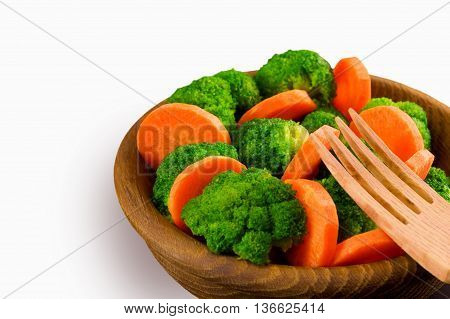 Vegetables. Broccoli and carrots on a plate. Diet concept. Healthy food. Macrobiotic.