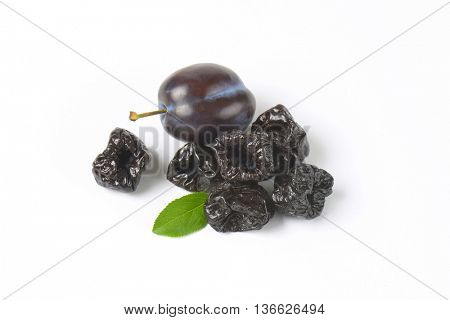 group of dried plums on white background