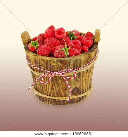 raspberries in wooden bowl. Ripe and tasty raspberry.