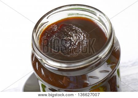 detail of jar of thick plum jam
