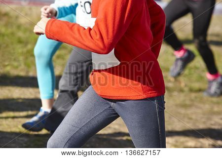 Young athletic runner on a cross country race. Outdoor circuit. Horizontal