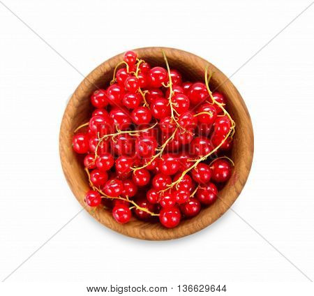 Redcurrant in a wooden bowl. Top view. Ripe and tasty currant isolated on white background.