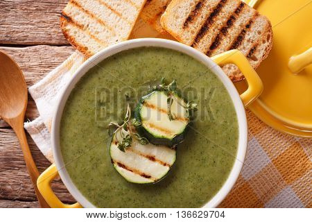 Zucchini Soup Close-up In Yellow Saucepan And Toast. Horizontal Top View