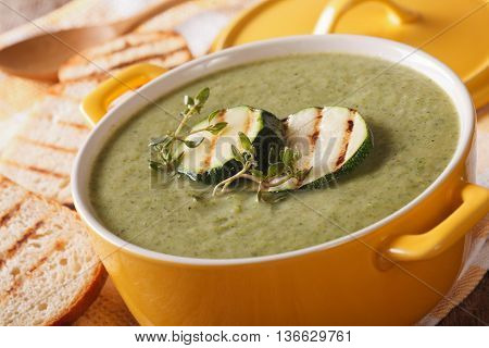 Cream Soup Of Zucchini With Herbs Close-up In A Saucepan. Horizontal