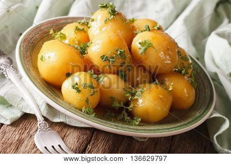 Glazed New Potatoes With Parsley Close-up On The Table. Horizontal