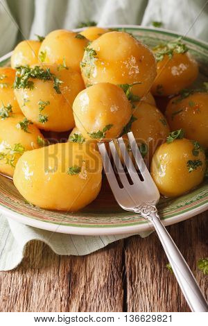 Danish Cuisine: Glazing New Potatoes With Parsley Close-up. Vertical