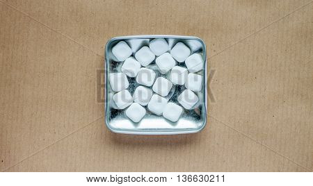 mint sweets in metal box against the craft background