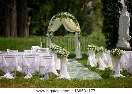 Beautiful wedding arrangement of seats along the aisle