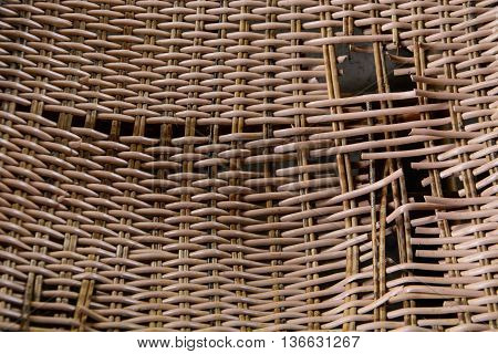 a broken rattan chair closeup on texture
