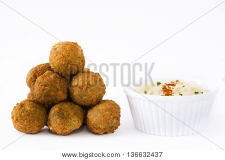 Vegetarian falafels and hummus isolated on white background