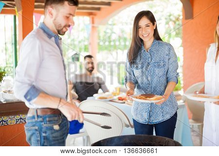 Happy Young Woman At A Grill