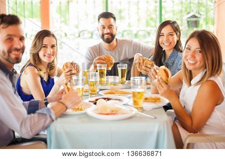 Group Of People Eating Hamburgers