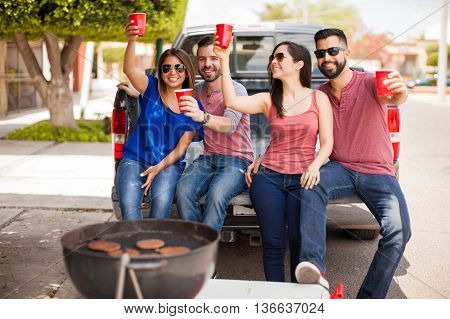 Friends Drinking And Having Fun Outdoors