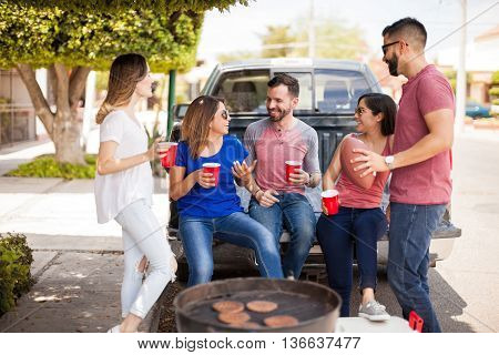 Friends Talking About Football In A Barbecue