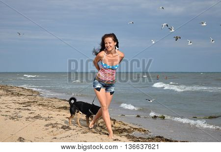 Happy Woman On Beach With Dog, Independence Day Usa