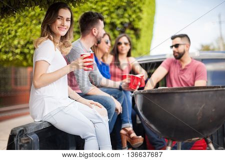 Pretty Young Woman Drinking With Friends