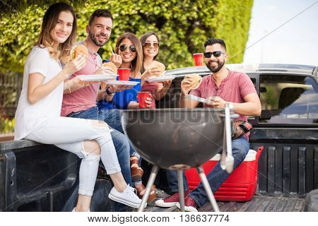 Having Fun And Eating Burgers Outdoors