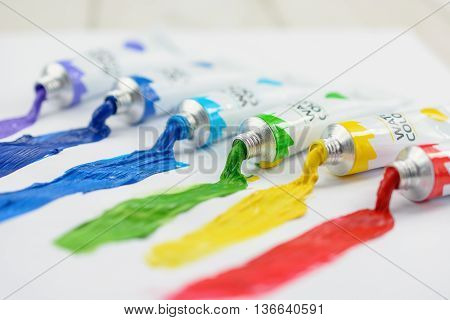 Colorful watercolor in tubes on a white background