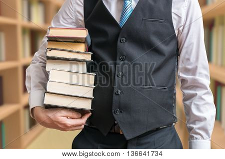 Student is borrowing many books in library.