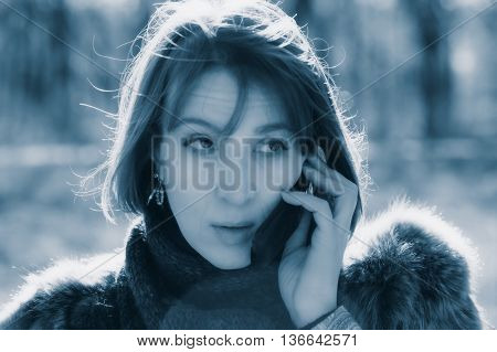 woman talking on the phone in the park