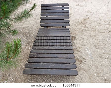 Wooden deck chair, pine and inscription of shells