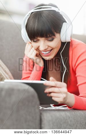 Woman With Headphones Using A Tablet