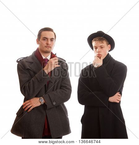 Two thoughtful well dressed adults thinking on white background