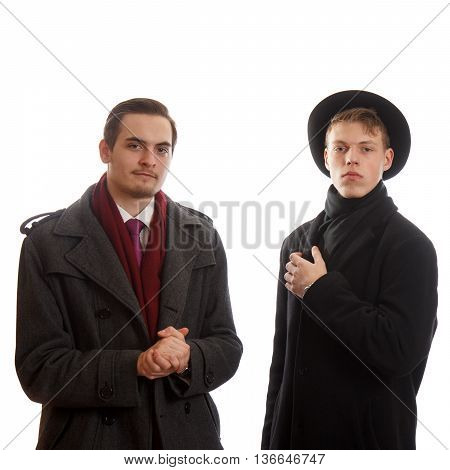 Two confident and pleased well dressed men on white background