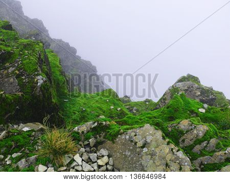 A abyss in the mist at the great mountains of Scotland