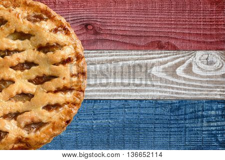 Fresh baked apple pie on a patriotic background for 4th of July or Memorial Day projects. Horizontal with Copy Space.