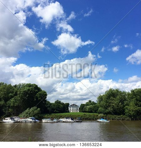 LONDON - JUNE 24: Marble Hill House and Park viewed from the south bank of the River Thames at Ham on June 24, 2016 in London, UK.