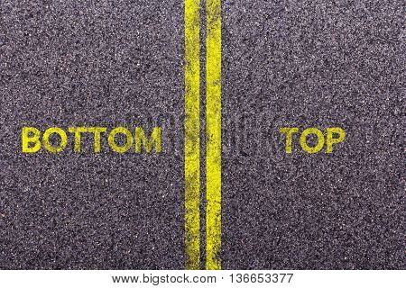 Tarmac With The Words Bottom And Top