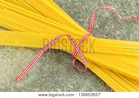 Uncooked Spaghetti With Vegetables A Stone Table