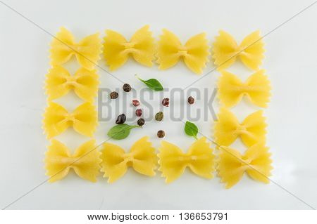 Farfalle Pasta Forming Shapes On White Background