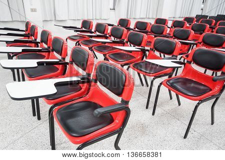red and black lecture chairs in a classroom