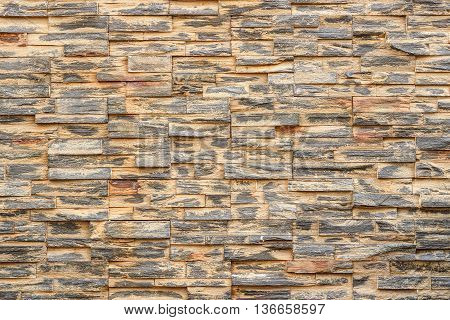 Grunge ledge stone wall background for design and decoration